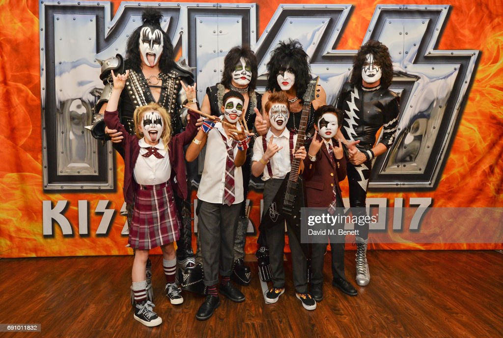 Gene Simmons, Eric Singer, Paul Stanley and Tommy Thayer of KISS pose with 'School Of Rock: The Musical' cast members (front L to R) Eliza Cowdery, Bailey Cassell, Toby Lee and Cole Lam at The O2 Arena on May 31, 2017 in London, England.