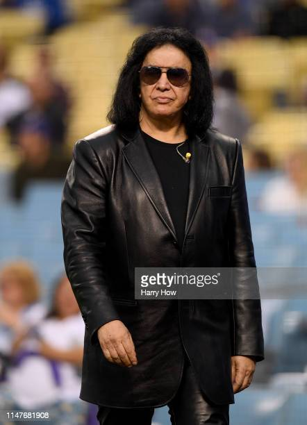 Gene Simmons makes his way on to the field to sing the National Anthem before the game between the Atlanta Braves and the Los Angeles Dodgers at...