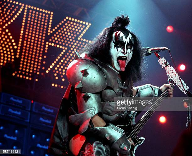 Gene Simmons member of the rock group KiSS strikes his traditional pose as the band performed at the Pond