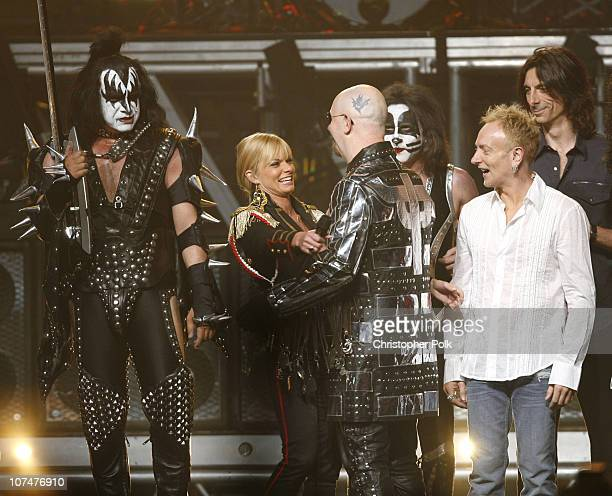 Gene Simmons of KISS host Jaime Pressly Rob Halford of Judas Priest Eric Singer of KISS Phil Collen of Def Leppard and Scott Travis of Judas Priest