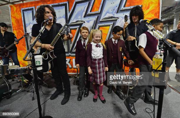 Gene Simmons Paul Stanley and Tommy Thayer of KISS meet 'School Of Rock The Musical' cast members Toby Lee Eliza Cowdery Cole Lam and Bailey Cassell...