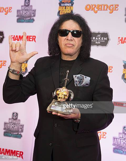 Gene Simmons poses with the Legend Award for Kiss during the Metal Hammer Golden Gods Awards 2015 at Indigo2 at The O2 Arena on June 15 2015 in...