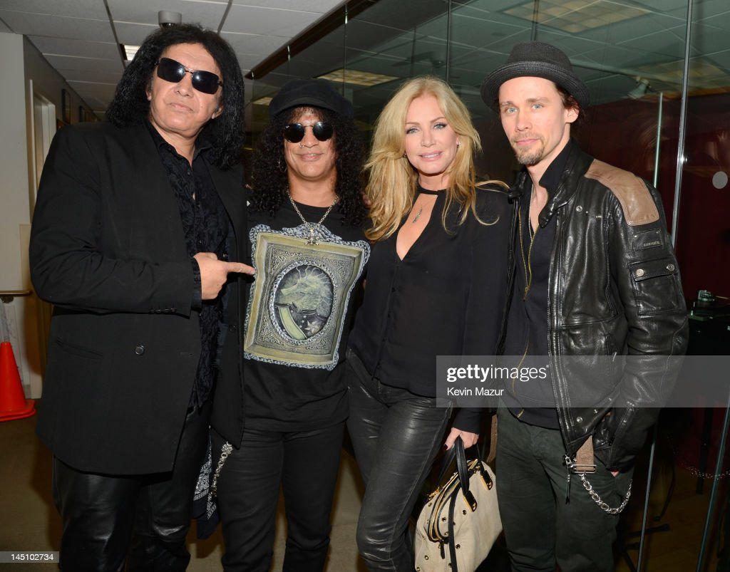 Gene Simmons, Slash, Shannon Tweed and Myles Kennedy backstage at the SiriusXM Studio on May 23, 2012 in New York City.