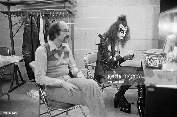 Gene Simmons the vocalist of hard rock band KISS backstage in Detroit with Larry Harris May 1975 Harris is the cofounder of Casablanca Records KISS'...