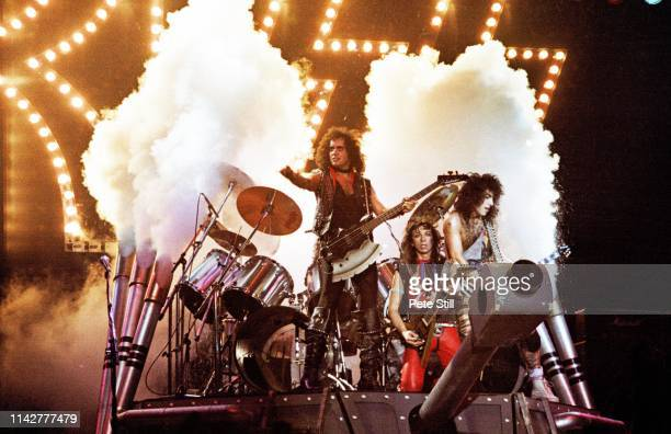 Gene Simmons Vinnie Vincent and Paul Stanley of American Heavy Metal group KISS perform on stage on the 'Lick It Up' tour the band's first without...