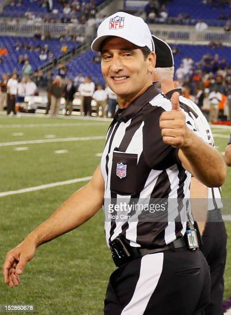 Gene Steratore gives the thumbs after the game officials took the field for the first time this season before the start of the Baltimore Ravens and...