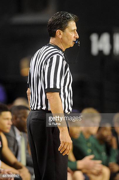 Gene Steratore officiates the game between the Maryland Terrapins and the Charlotte 49ers at Royal Farms Arena on December 20, 2016 in Baltimore,...