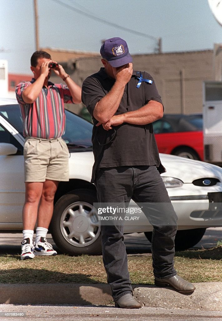 Gene Tarplay of Chocktaw, Oklahoma, cries 21 April 1995 in Oklahoma City as he waits for news on friends that are still missing following 19 April a fuel-and fertilizer truck bomb explosion in front of the Albert P. Murrah Federal Building in Oklahoma City. The blast, the worst terror attack on US soil, killed 168 people and injured more than 500. Timothy McVeigh, convicted on first-degree murder charges for the 19 April bombing was sentenced to death in 1997.
