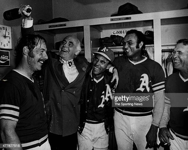 Gene Tenace Owner Charlie Finley Bert Campaneris Jesus Alou and coach Vern Hoscheit of the Oakland Athletics celebrate in the locker room after they...