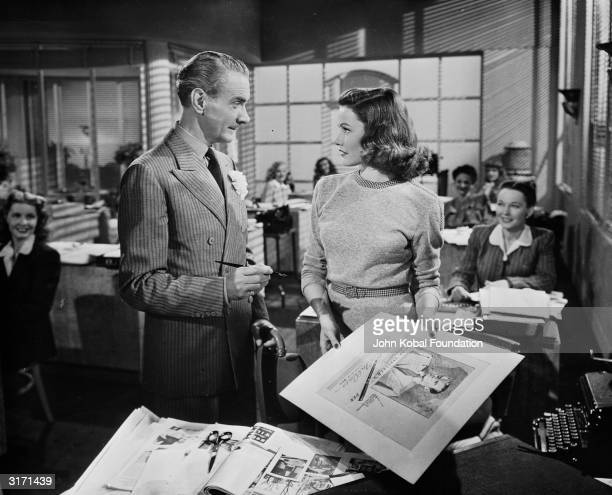 Gene Tierney as Laura Hunt and Clifton Webb as Waldo Lydecker in a scene from the 20th Century Fox film noir 'Laura' directed by Otto Preminger