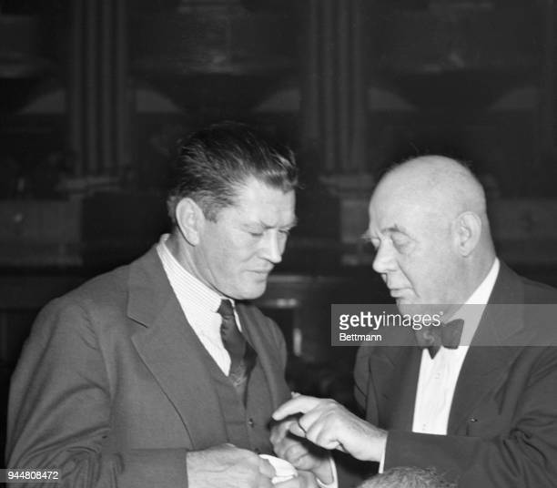 Gene Tunney and Grantland Rice two famous names in sports talk things over at the Banshee Luncheon held for the editors and publishers attending the...