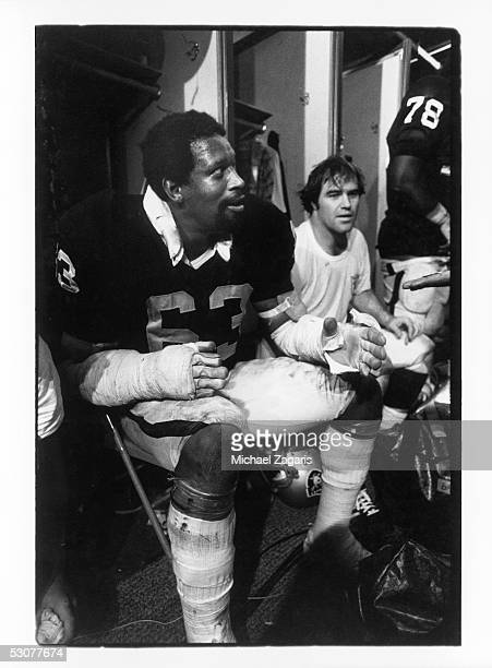 Gene Upshaw of the Oakland Raiders sits in the locker room following the 1976 AFC Divisional Playoff game against the New England Patriots at the...