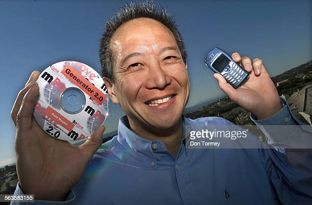 Gene Wang Chairman and CEO of Bitfone Corp holds a the software his company produces for use with cellphones His Laguna Niguel software company got...