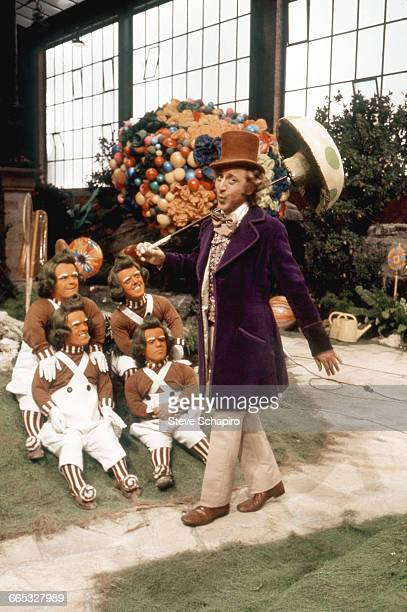 Gene Wilder as Willy Wonka walks past a group of Oompa Loompas on the set of the movie Willy Wonka the Chocolate Factory 1971