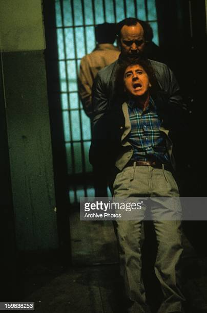 Gene Wilder being taken away against his will in a scene from the film 'See No Evil, Hear No Evil', 1989.