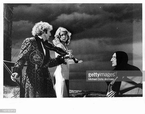 Gene Wilder plays violin for Teri Garr as Marty Feldman watches in a scene from the film 'Young Frankenstein' 1974