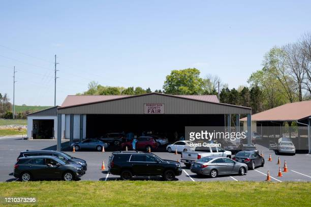 Genearl view of cars lined up awaiting drive thru coronavirus testing on April 18, 2020 in Springfield, Tennessee. Tennessee drive thru testing sites...