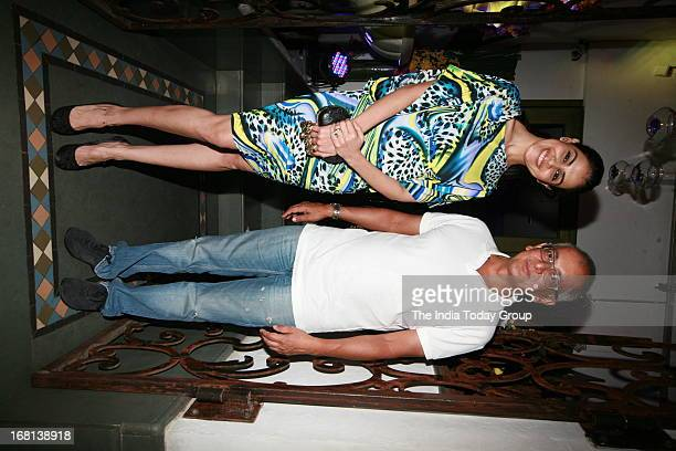 Genelia D'Souza and Juhi Chawla's husband Jay Mehta pose during KKR's victory party in Bandra on May 4th 2013