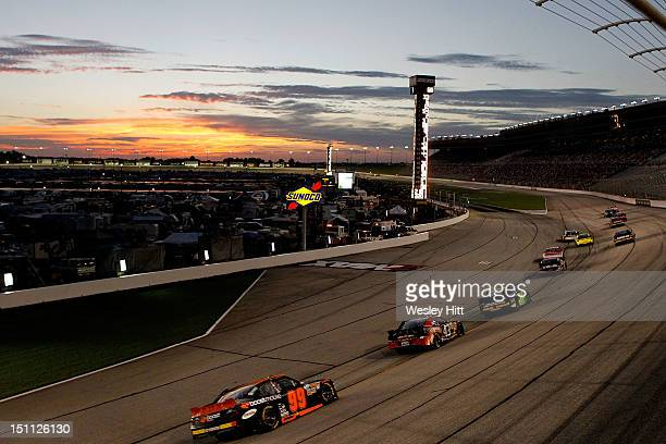 A gener view of cars racing as the sun sets during the NASCAR Nationwide Series NRA American Warrior 300 at Atlanta Motor Speedway on September 1...