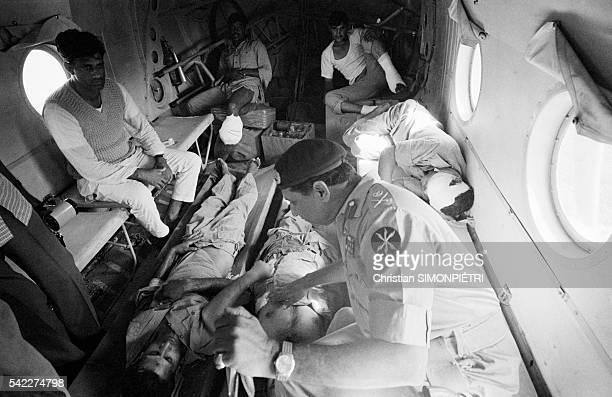 General Niazi head of the east Pakistan army accompanies soldiers wounded at the front in a plane during the war for Bangladeshi independence