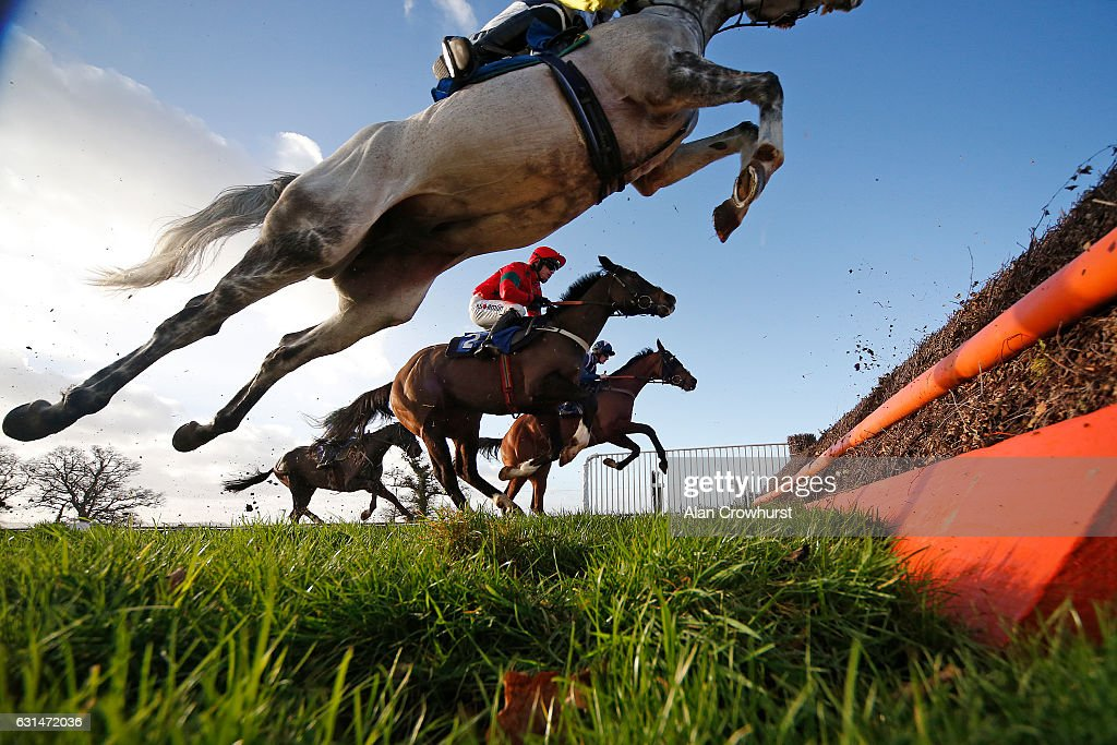 General action as runners clear a fence at Taunton Racecourse on January 11, 2017 in Taunton, England.