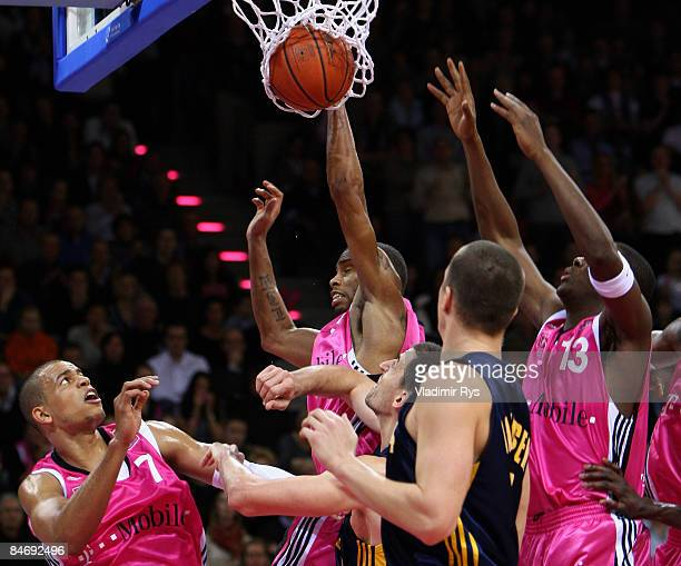 General action is seen under the ALBA basket during the Bundesliga game between Telekom Baskets Bonn and ALBA Berlin at the Telekom Dome on February...