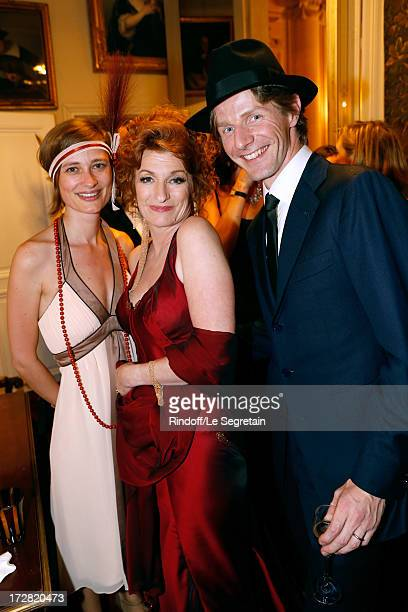General administrator of Comedie Francaise Muriel Mayette standing between Star dancer Karl Paquette and wife Marion attend Le Grand Bal De La...