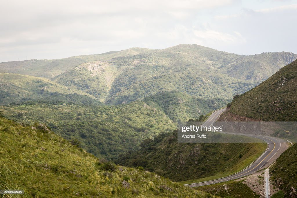 General aerial view of mountains and a hilly route : Stock Photo