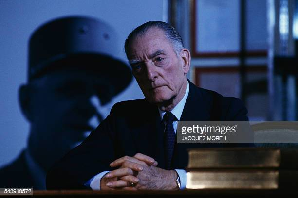 General Alain de Boissieu with in the background a photograph of his fatherinlaw General Charles de Gaulle