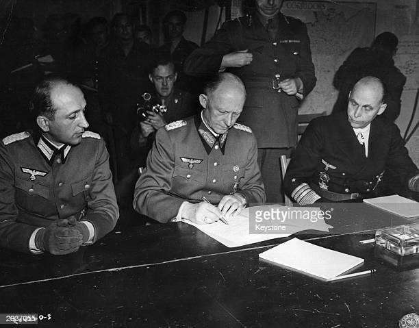 General Alfred Jodl Hitler's military advisor controller of German High Command and chief of the Operations Staff signs the document of surrender of...