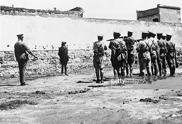 General Alfredo Ruedo Quijano a leader in the Mexican Revolution is executed in a prison by firing squad