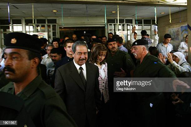 General Ali Hassan al Majeed known as 'Chemical Ali ' stands next to his wife during a referendum October 15 2002 in Baghdad Iraq Ali Hassan alMajid...