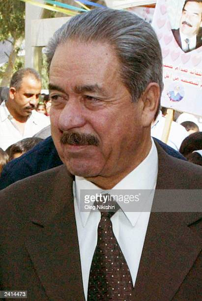 General Ali Hassan al Majeed known as 'Chemical Ali ' walks during a referendum October 15 2002 in Baghdad Iraq Military officials said on August 21...