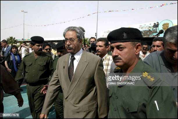 General Ali Hassan Al Majid surrounded by bodyguards