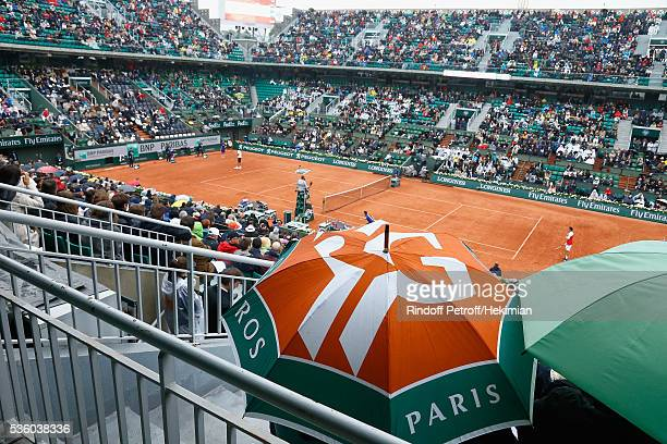 A general ambiance of atmosphere of a rainy day with umbrellas in the court Chatrier pictured during the match between Novak Djokovic and Roberto...