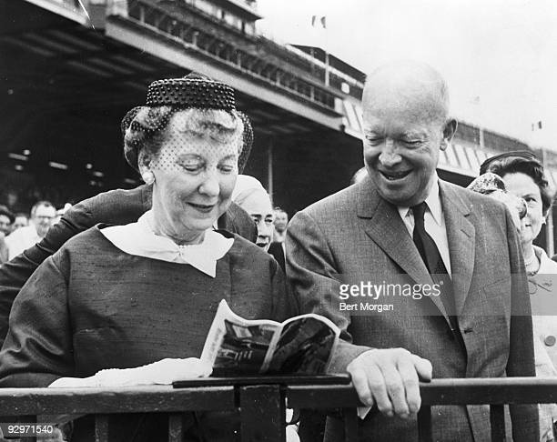General and Mrs Dwight Eisenhower looking at a racing bill at the Belmont Park racetrack Elmont NY June 3 1961