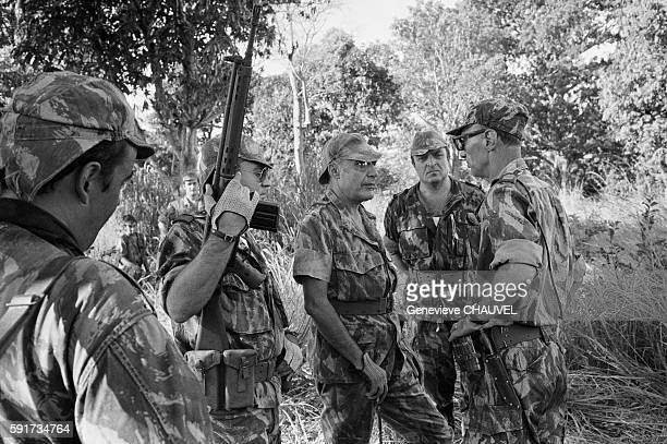 General Antonio de Spinola after being removed from office as Deputy Chief of Staff speaking with soldiers in a jungle area of GuineaBissau