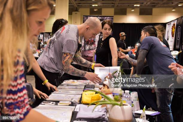 "General atmosphere during day two of the ""19th Annual Northern Ink Xposure Tattoo Convention"" at the Metro Toronto Convention Centre on June 10, 2017..."