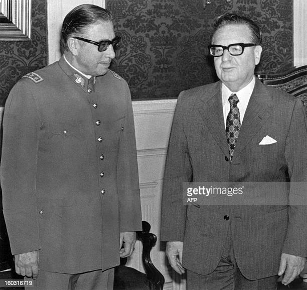 General Augusto Pinochet poses with Chilean president and Marxist leader Salvador Allende 23 August 1973 in Santiago shortly after Allende appointed...