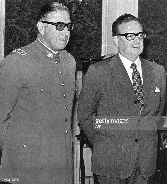 General Augusto Pinochet poses with Chilean president Salvador Allende 23 August 1973 in Santiago shortly after Allende appointed him the head of the...