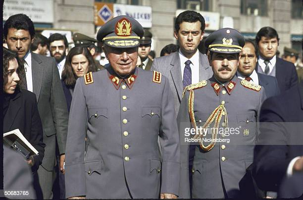 General Augusto Pinochet President of Chile in military garb with others en route to palace