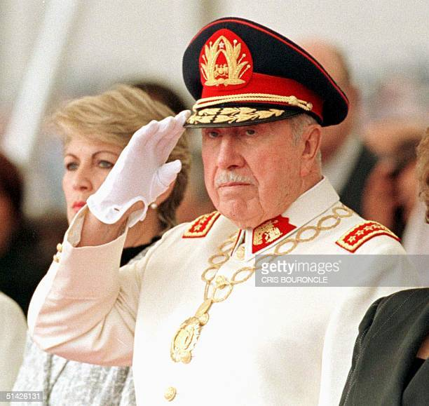 General Augusto Pinochet salutes during a military parade in honor of his retirement as commander of the Chilean Army 06 March in Santiago. Pinochet...