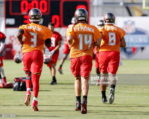 A general back view of Quarterbacks Jameis Winston Ryan Fitzpatrick and Sefo Liufau of the Tampa Bay Buccaneers during Training Camp at One Buc Place...
