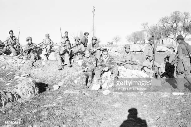 General Bellounis. Algérie, Diar-El-Chouki- 11 Décembre 1957- Reportage au PC du Général BELLOUNIS: une unité de maquisards en uniforme de 'l'Armée...