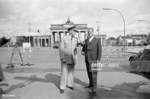 General Bruce C Clarke Commander In Chief of the US Army in Europe at the Brandenburg Gate with West Berlin Mayor Willy Brandt three days after...