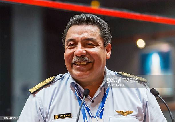 General Carlos Rodriguez of the Peruvian Space Agency speaks to journalists at a control center during the Vega rocket launching from the European...