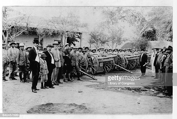 General Carranza José María Maytorena and General Alvaro Obregón and rebel forces stand beside their cannons in the plaza of Hermosillo during the...