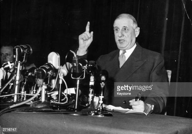 General Charles de Gaulle addresses journalists at a press conference in the year he became president of the French Fifth Republic