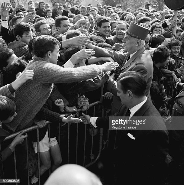 General Charles de Gaulle among the crowd after the great army manoeuvres with 9 000 men, helicopters, fighters and armoured vehicles on October 13,...