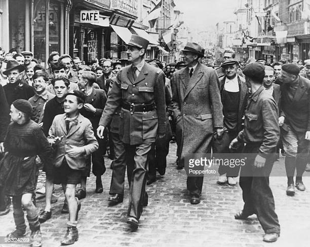 General Charles de Gaulle arrives in Paris to celebration the Liberation of the city during World War II 26th August 1944